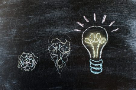 Chalkboard with Chalk Drawing of Hanging Light Bulb. Bright idea on blackboard concept. Way of thinking, the birth of idea. Creative, bright, unusual, interesting idea. Eureka, thought, flash, inspiration.